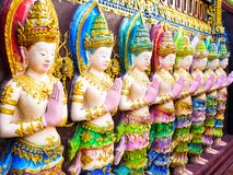 Scalptures of male angles. A colorful scalptures of standing male angles on a temple wall royalty free stock photos