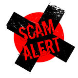 Scam Alert rubber stamp Royalty Free Stock Photos