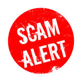 Scam Alert rubber stamp Stock Image