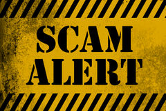 Scam alert  sign yellow with stripes Stock Photography