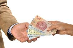 Scambio di soldi Fotografia Stock