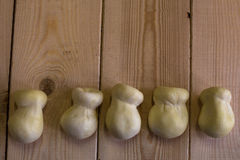 Scamorza cheese on wood background Royalty Free Stock Photos