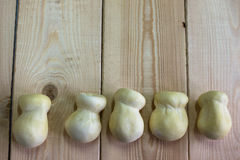 Scamorza cheese on wood background Royalty Free Stock Image