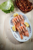 Scampi. Boiled scampi with lemon slices Royalty Free Stock Image