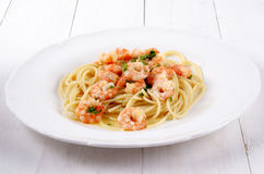 Scampi with butter white wine sauce and spaghetti Royalty Free Stock Images