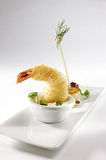 Scampi. Decorated scampi on a white plate Royalty Free Stock Images