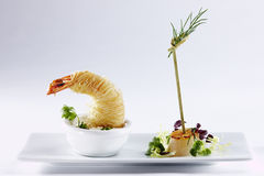Scampi. Decorated scampi on a white plate Royalty Free Stock Image