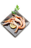 Scampi with lemon and parsley Royalty Free Stock Images