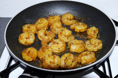 Scampi Shrimp in pan. Frying pan with lots of shrimps scampi Stock Photography