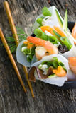Scampi with spring rolls Royalty Free Stock Photography