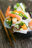 Scampi with spring rolls Stock Photos
