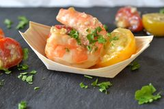 Scampi and tomatoes. Grilled scampi with baked cherry tomatoes Stock Images