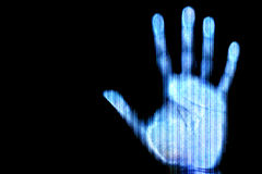 Scan of human hand. Blue scanned hand - future and internet protection concept Royalty Free Stock Image