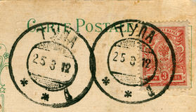 Scan of old 1900's postmarks and postage stamp. High resolution. original rich texture preserved Royalty Free Stock Photo