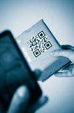 Scan with smartphone of qr code Stock Photos