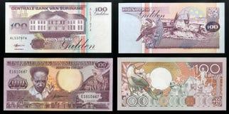 Scanarray två sedlar av centralbanken av Surinam hundra gulden tar prov 1986 och 1998 Royaltyfria Bilder