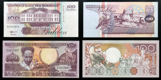 Scanarray two banknotes of the Central Bank of Suriname hundred guilders sample 1986 and 1998. Royalty Free Stock Images