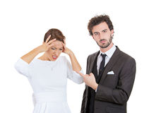 Scandal. Couple fighting. Closeup portrait stressed young couple going through relationship hard times isolated white background. Upset angry husband blaming his stock photography