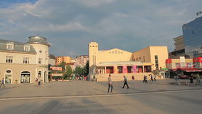 Scanderbeg Square Pristina. PRISTINA, KOSOVO - JULY 01, 2015: People walking by the old theater on Scanderbeg square in city center stock video footage