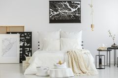 Scandi bedroom with contemporary paintings Stock Photo