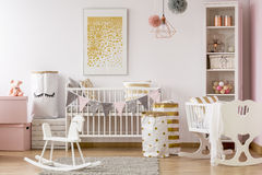 Scandi style baby room. With white cot, cradle, rocking horse Royalty Free Stock Photos