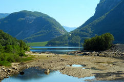 Scandinavia, Norway. Beautiful Scandinavian fjord in Norway with blue water with mountains,trees clouds in background stock photography