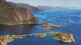 Scandinavia, Norway, Nordic Rugged Landscape, Lofoten Islands. Aerial view - Idyllic Norwegian Fjord with island mountains and Reine fishing village on Lofoten royalty free stock photos