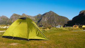 Scandinavia, Norway, Nordic Rugged Landscape, Lofoten Islands. Idyllic Norwegian campground with tent and RV cars in mountains on Lofoten Islands, Norway royalty free stock photo