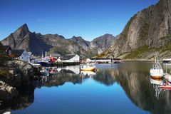 Scandinavia, Norway, Nordic Rugged Landscape, Lofoten Islands. Idyllic Norwegian Fjord with typical wooden log cabins and ships on Lofoten Islands, Norway stock images