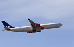 Scandinavian Airlines - Airbus A340. Scandinavian Airlines Airbus A340 taking off from Copenhagen Airport Stock Image