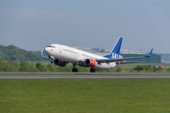 Scandinavian airlines Boeing 737 departing Manchester airport. MANCHESTER, UNITED KINGDOM - MAY 07, 2018: Scandinavian airlines Boeing 737 departing Manchester stock photo