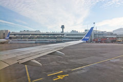 Scandinavian Airlines at Stockholm Arlanda airport. STOCKHOLM, SWEDEN - DECEMBER 25, 2016: Scandinavian Airlines jetliners line up outside the gates at the royalty free stock photo