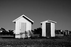 Scandinavian beach houses in black and white. Two small beach houses on scandinavian beach in black and white Stock Photography