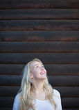 Scandinavian blonde woman posing on wood background Royalty Free Stock Photos