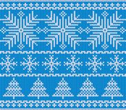 Scandinavian Christmas pattern. Knitting. Christmas trees and snowflakes Royalty Free Stock Images