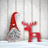 Scandinavian christmas traditional gnome, Tomte, with abstract decoration in shape of reindeer, illustration Royalty Free Stock Images
