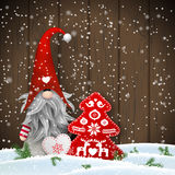 Scandinavian christmas traditional gnome, Tomte with other seasonal decorations, illustration Royalty Free Stock Image