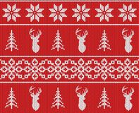 Scandinavian christmas winter seamless knitted pattern. Head deer silhouette or reindeer, snowflake and christmas tree. White pixel images with red background Royalty Free Stock Images