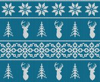Scandinavian christmas winter seamless knitted pattern. Head deer silhouette or reindeer, snowflake and christmas tree. Stock Photo