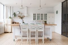 Scandinavian classic kitchen with wooden and white details, minimalistic interior design. Real photo. stock image