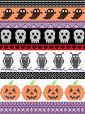 Scandinavian cross stitch and traditional American holiday inspired seamless Halloween pattern with owl,skull, heart, pumpkin Stock Photography