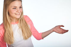 Scandinavian cute young girl. With arm like showing something Royalty Free Stock Photography