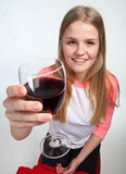 Scandinavian cute young girl holding a glass of wine in the air Stock Photo