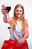 Scandinavian cute young girl holding a glass of wine in the air Stock Photos