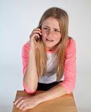 Scandinavian cute young girl   on the phone Royalty Free Stock Image