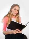 Scandinavian cute young girl reading a book Royalty Free Stock Photo