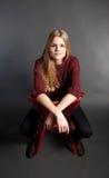Scandinavian cute young girl sitting on a chair Stock Photo