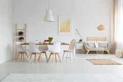 Dining space in loft. Scandinavian elegant dining space in contemporary loft Royalty Free Stock Photos