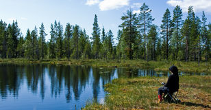Scandinavian fishing. Fishing in a calm swedish lake on a sunny day Stock Image