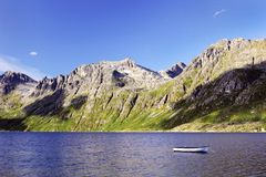 Scandinavian fjords - mountains, sea and blue sky Stock Photos
